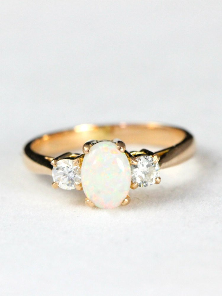 Rose Gold Opal And Diamond Engagement Ring In 18 Carat
