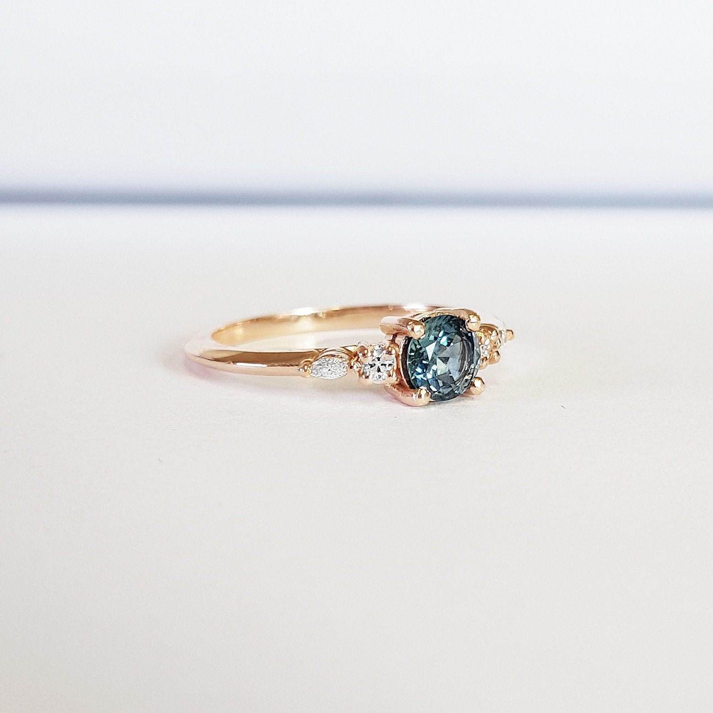 Teal Sapphire Engagement Ring Handmade In Rose White Yellow Gold With Diamonds Marquise 5 Stone Antique Inspired Aardvark Jewellery